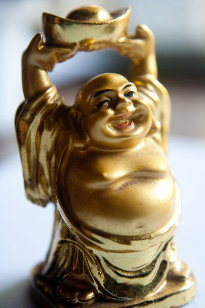 Laughing Buddha - 10 best lucky charms for gamblers - Translation Royale