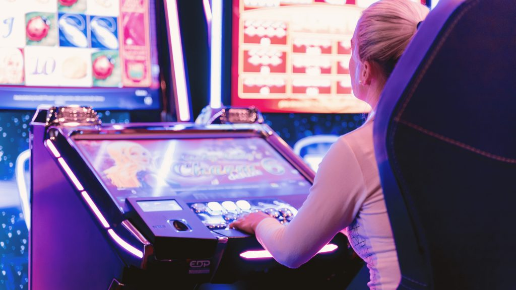 A woman playing at a casino - Women in iGaming - Translation Royale