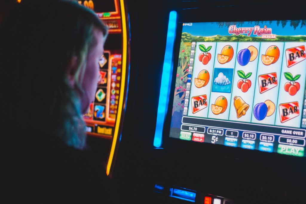 A woman playing slots at a casino - Women in iGaming - Translation Royale