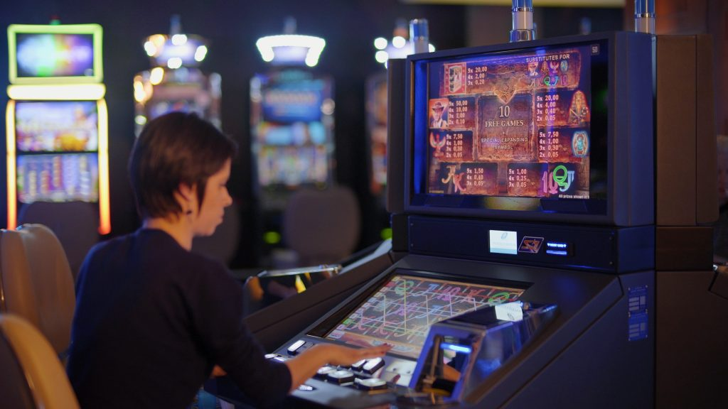Woman playing slots at a casino - A Complete Guide to Creating Content Marketing Personas for iGaming Brands - Tranlation Royale